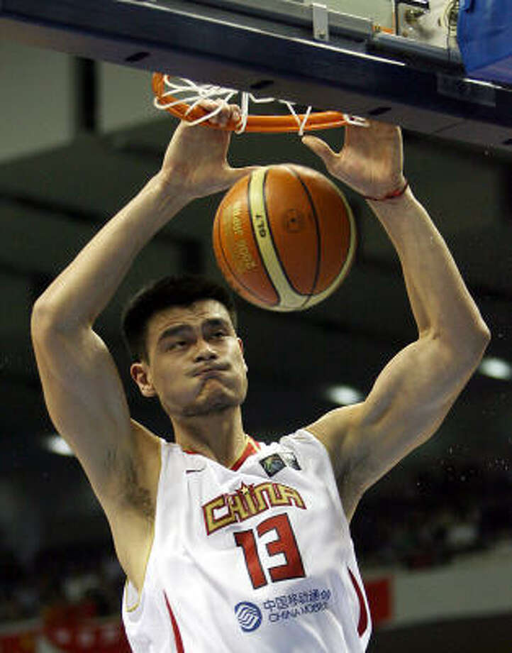 China's Yao Ming dunks during their opening game of the Group D preliminary round in the World Basketball Championship against Italy. Photo: TOSHIFUMI KITAMURA, AFP/Getty Images