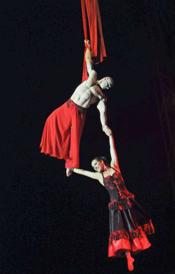 """Havana is hosting the 10th International Festival of Circus """"Circuba""""  from August 8 to 14, 2011, drawing more than 100 circus artists from 14  countries. Here, Priscila and Richard from the Brazilian UNICIRCO company perform on August 11. Photo: STR, AFP/Getty Images / 2011 AFP"""