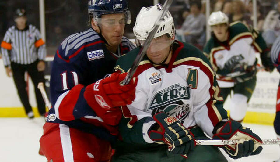 Aeros' Wyatt Smith, right against the Griffins, scored the lone goal in Thursday's 3-1 loss to the Stars. Photo: Thomas B. Shea, For The Chronicle