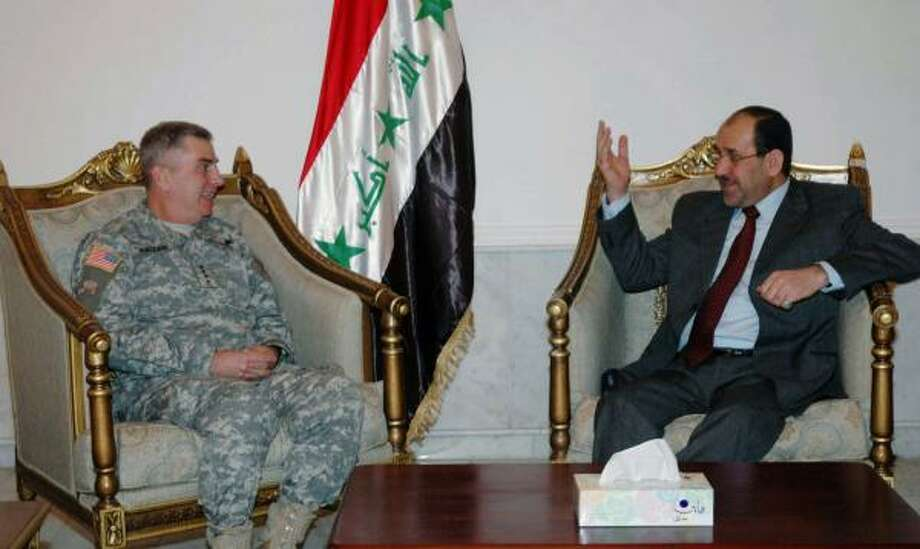 General John Abizaid, left, met with Iraqi Prime Minister Nuri al-Maliki Monday in Baghdad to discuss security in the region. Photo: REUTERS