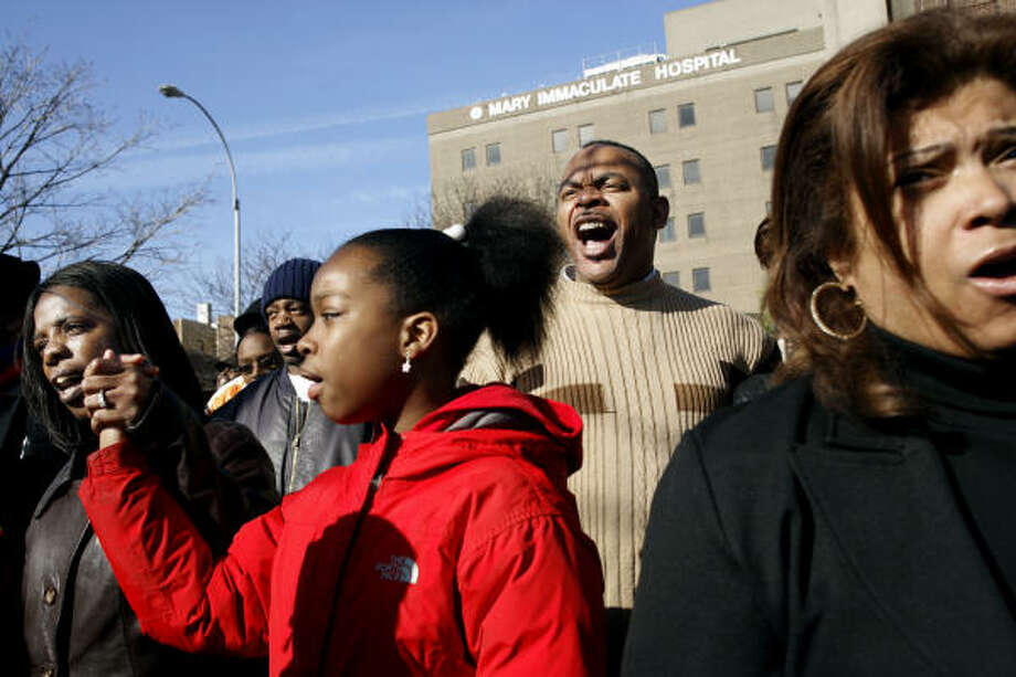 Supporters gather outside the Mary Immaculate Hospital in the Queens borough of New York today during a rally and vigil. Trent Benefeld, 23, Joseph Guzman, 31, and Sean Bell, 23, who were attending a bachelor party at a Queens strip club were shot by police officers just after leaving early Saturday. Photo: ADAM ROUNTREE, AP