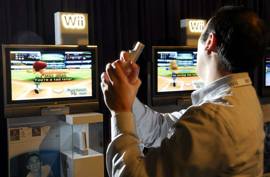 Matt Tattle plays a game of baseball on the Nintendo Wii gaming system at a preview in Toronto. Photo: AARON HARRIS, AP