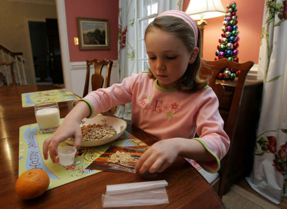 "Since 7-year-old Elizabeth White began taking her ""peanut medicine,"" her parents say they no longer have to worry about a dangerous allergic reaction every time she goes somewhere without them. Photo: GERRY BROOME, AP"