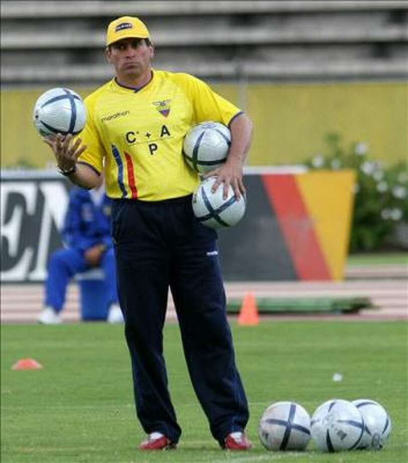 Ecuador's national football team coach, Luis Fernando Suarez, carries balls during practice at the Atahualpa Olympic Stadium, 24 March 2005 in Quito. Ecuador will meet Paraguay in a World Cup qualifying match. Photo: RODRIGO BUENDIA, AFP