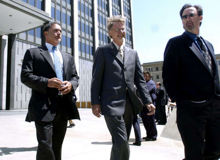 San Francisco Chronicle editor Phil Bronstein, left, and reporters Lance Williams, middle, and Mark Fainaru-Wada leave federal court Friday. Photo: BENJAMIN SKLAR, AP