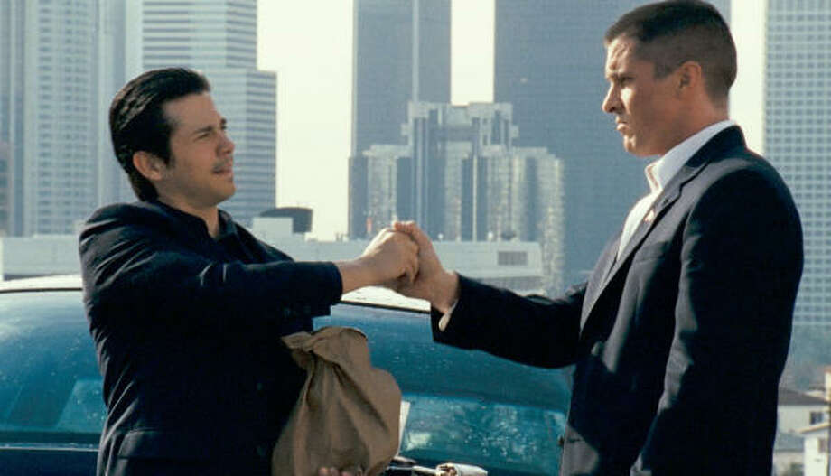 Terrible choices lead bad-boy buddies Mike (Freddy Rodriguez, left) and Jim (Christian Bale) in the wrong direction in Harsh Times. Photo: MGM