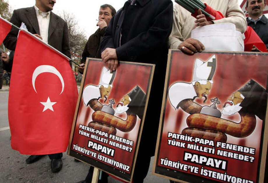 Turkish nationalists protest the planned visit to Turkey by Pope Benedict XVI. In Instanbul, Ecumenical Patriarch Bartholomew I said the pope's visit would be good for the country. Photo: MURAD SEZER, AP