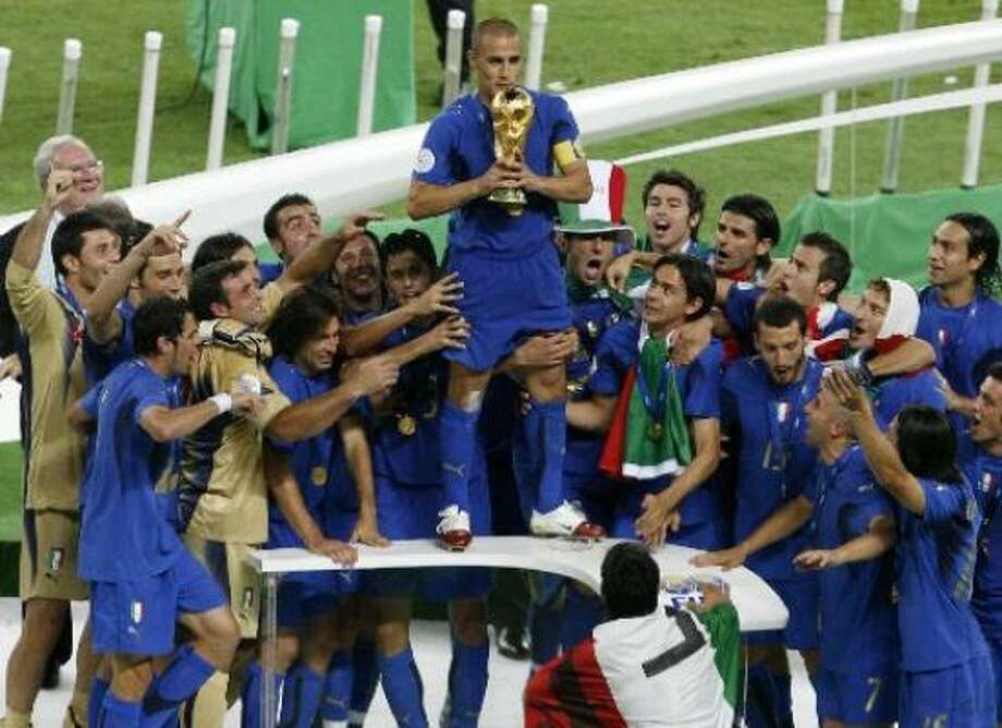 Italy's Fabio Cannavaro holds the trophy after beating France 5-3 in a penalty shootout in the World Cup final. Photo: Andrew Medichini, Associated Press