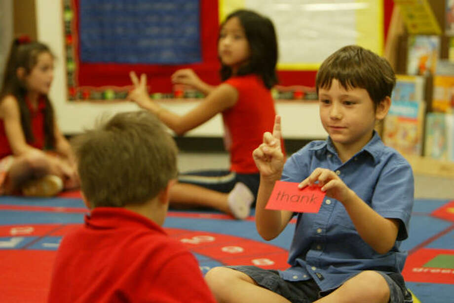 Seven-year-old Deven Habisreitinger, right, participates in a word exercise last week at a summer reading academy at La Porte Elementary. Photo: Nick De La Torre, CHRONICLE
