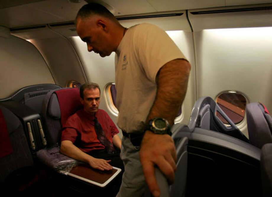 JonBenet Ramsey slaying suspect John Mark Karr sits next to a plane window in business class on his way to Los Angeles on Sunday. Photo: ELIZABETH DALZIEL, AP
