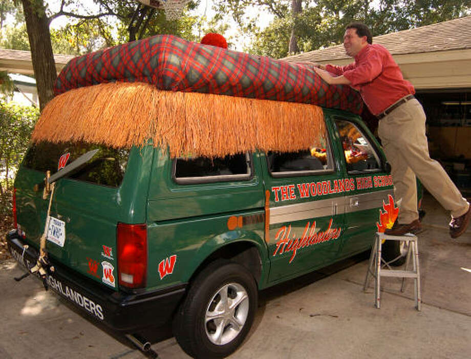 Michael Knight of The Woodlands, checks out the Green Machine, a 1988 Plymouth Voyager he transformed into a motorized Scottish plaid hat and popular symbol of school spirit at The Woodlands High School.   Photo: David Hopper, For The Chronicle