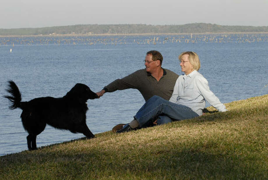 Michael and Judith Sutter, originally from the Chicago area, have a backyard overlooking the Toledo Bend Reservoir. Photo: Tony Bullard, For The Chronicle