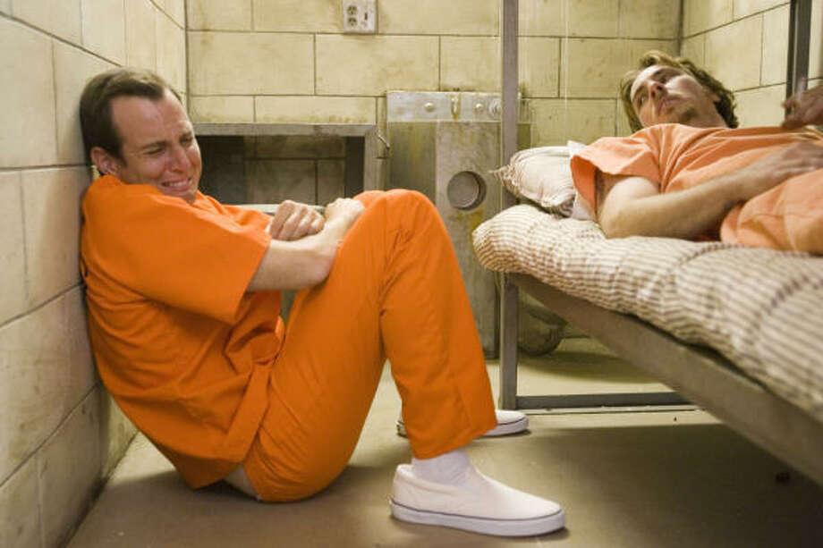 Nelson Biederman IV (Will Arnett, left) bemoans his fate to fellow felon John Lyshitski (Dax Shepard), in Let's Go To Prison. Photo: Universal