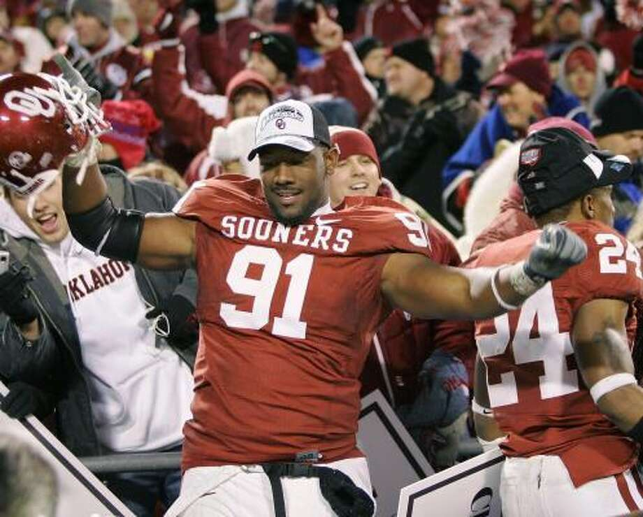 Oklahoma (with lineman Alonzo Dotson) has earned a shot at another national title, but it won't get its chance. Photo: Brian Bahr, Getty Images