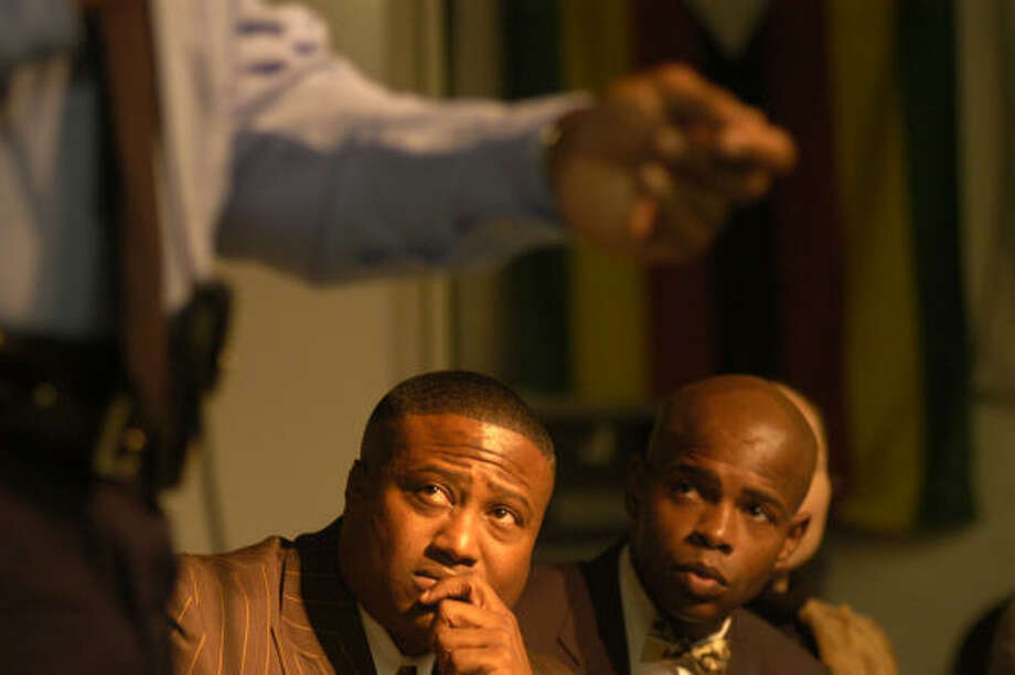 Activist Quanell X, center, and others listen as the HPD's Charles McClelland discusses Tasers. Photo: Johnny Hanson, For The Chronicle