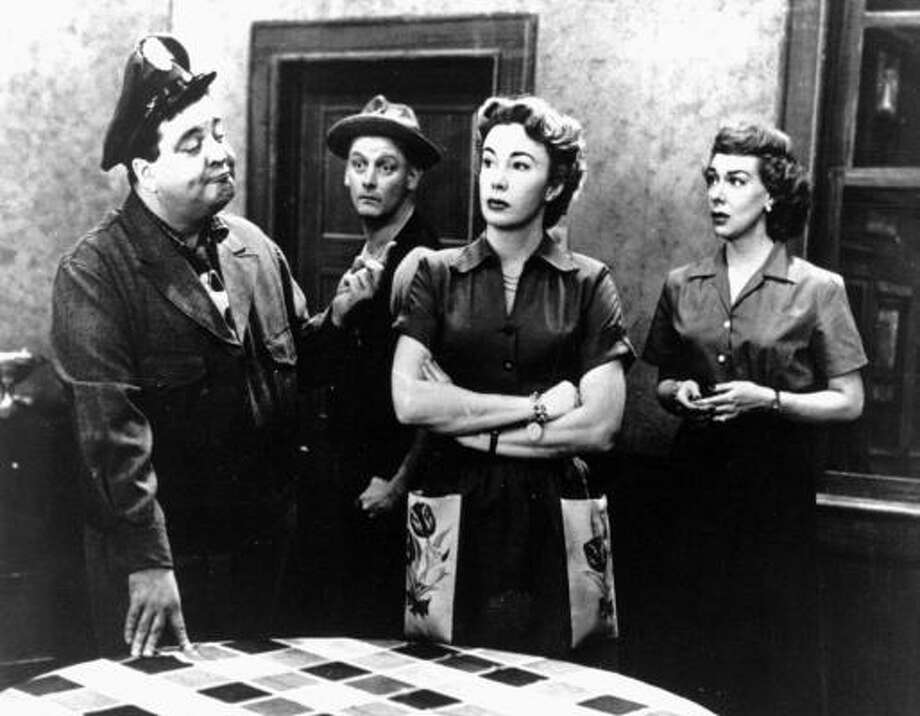 BABY, YOU'RE THE GREATEST!: Jackie Gleason, from left, coined the phrase on The Honeymooners, also starring Art Carney, Joyce Randolph, and Audrey Meadows. Photo: Associated Press