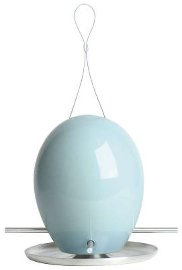 The egg bird feeder is available in several colors and is handmade of ceramic earthenware. Its glossy surface supposedly prevents squirrels from getting a grip. Photo: Design Within Reach