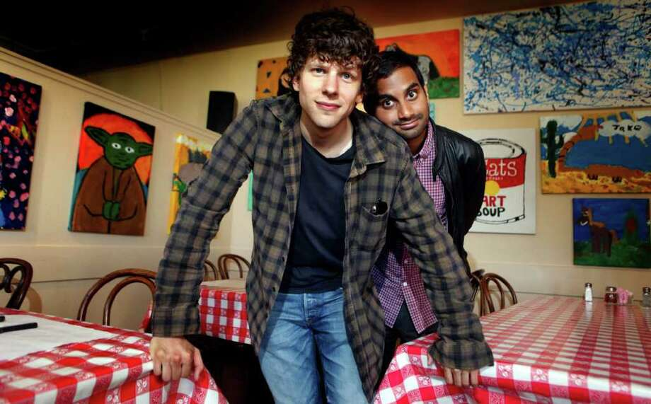 """Actors Jesse Eisenberg (left) and Aziz Ansari, at Goat Hill Pizza in Potrero Hill, find it funny that they play guys wielding guns and getting shot at in """"30 Minutes or Less,"""" which is inspired by a real-life crime. Photo: Lance Iversen, Staff / ONLINE_YES"""