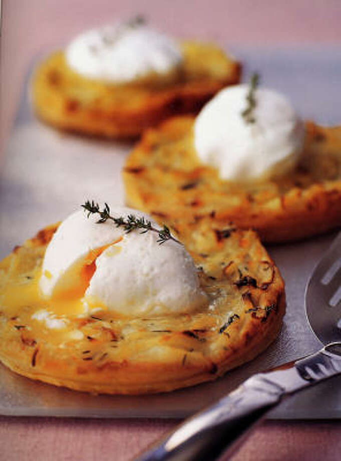 A twist on an old favorite: Michel Roux's Poached Eggs on Onion Tartlets. Photo: Martin Brigdale, Wiley