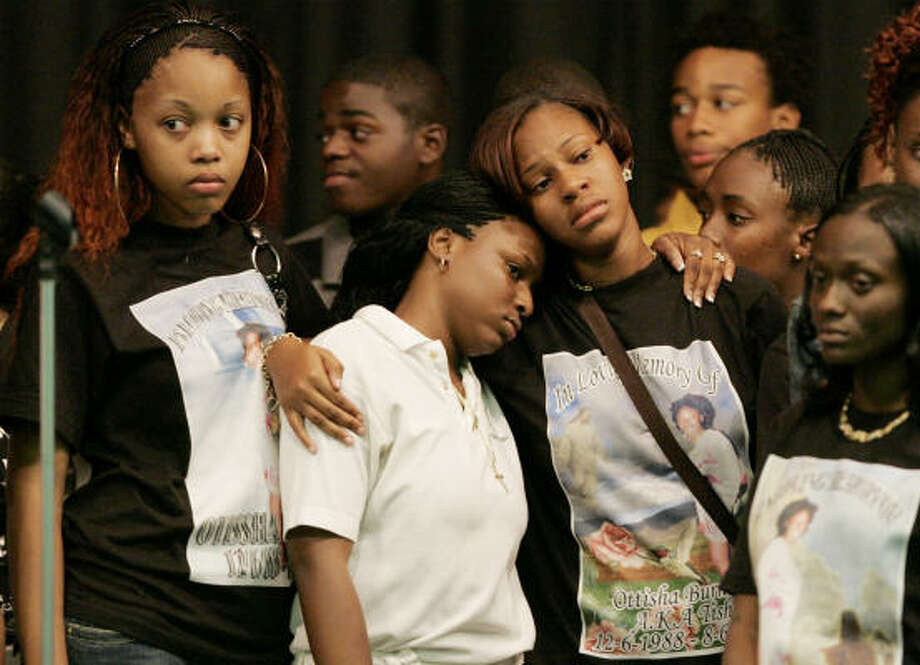 Friends wear T-shirts displaying Otissha Burnett's photograph during a memorial at Miami Central High School on Wednesday. Burnett, 17, was fatally shot at a party last weekend. Photo: LYNNE SLADKY, AP
