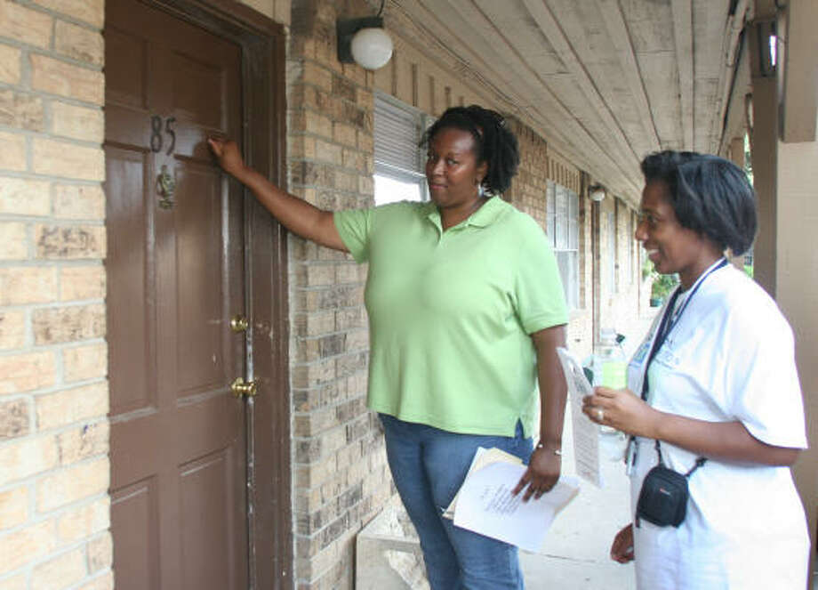 More than 1,400 volunteers, including Sharpstown teachers Alfee Herron, left, and Dee Wallace, went door to door to meet with dropouts during the third year of the Houston Independent School District's annual Reach Out to Dropouts walk. Photo: DONNA CARSON, AP