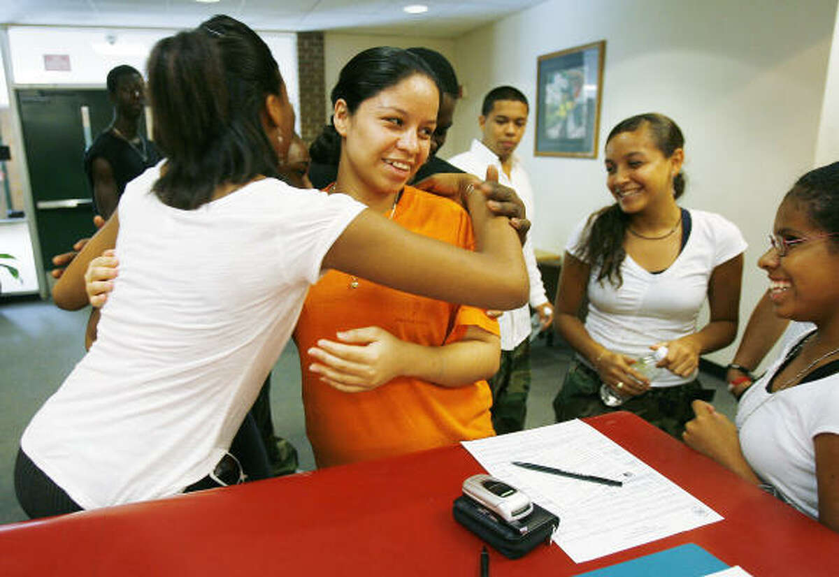 Members of Sharpstown High School's Apollo Funk dance group greet 18-year-old Diocelina Garcia, center, when she returned to the school Saturday to fill out paperwork. Dance team members, from left, are: Kayla Lee, Armando Martinez, Claudia Martinez and Natalia Cornejo.