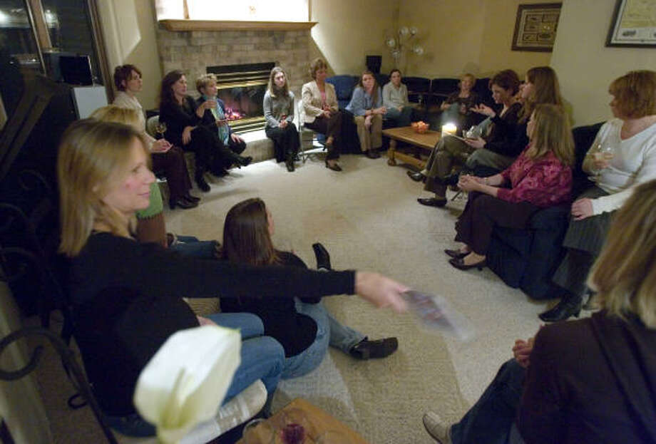 Members of the Giving Empowers My Sisters meet in a member's home in Oshkosh, Wis. The group pools members' contributions to donate to charitable causes. Photo: MORRY GASH, AP