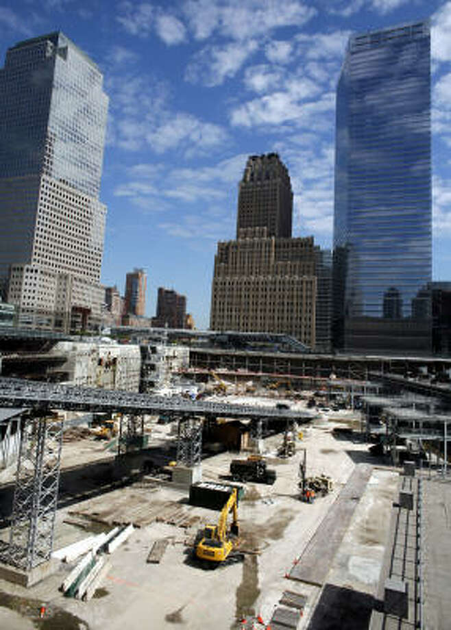 Construction on a World Trade Center memorial continues while site tours are being conducted in New York. Photo: JASON DECROW, Associated Press