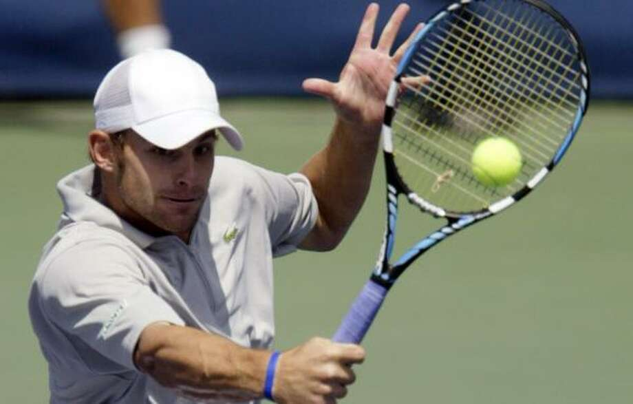 Andy Roddick returns a shot during his 6-3, 6-4 victory over Juan Carlos Fererro on Sunday. Photo: JAY LAPRETE, REUTERS