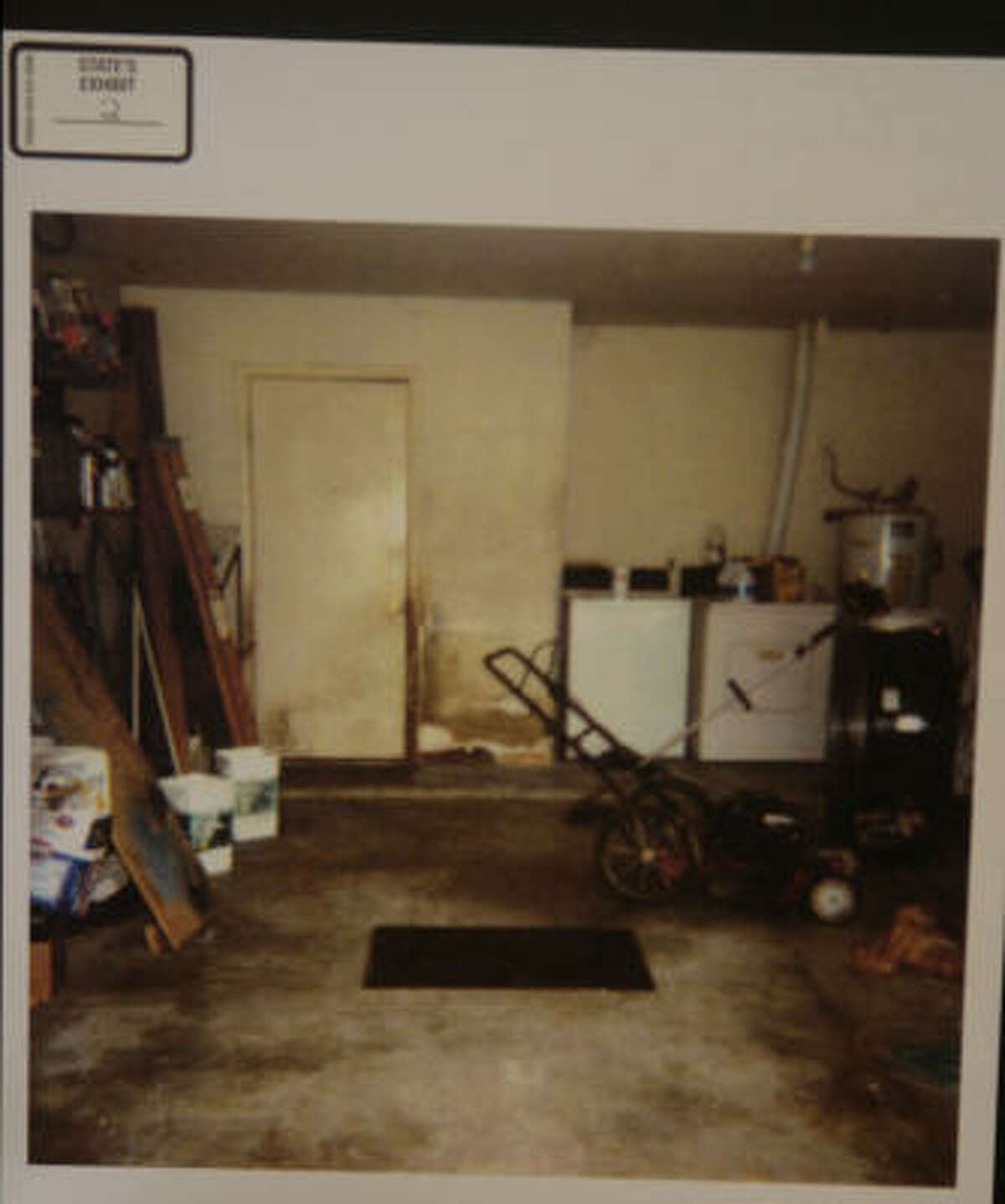 Court room photo placed into evidence showing the windowless garage that two brothers were forced to live in on cots by their foster parents, Barbara Dean Baldwin and Tommy Lee Baldwin, four years ago in Fort Bend County.