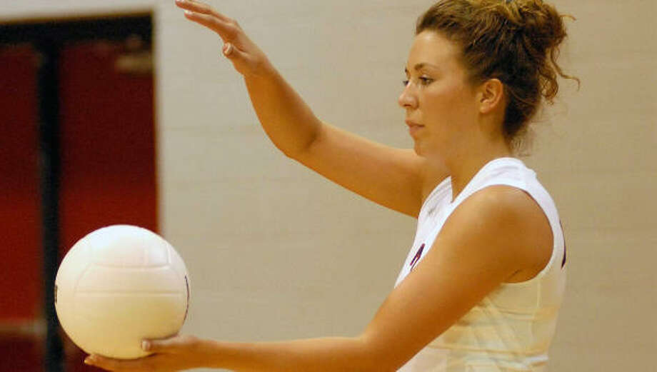 Heather Myklebust did her part in helping Fort Bend Austin top Dulles with 18 kills. Photo: Ernie Chan, For The Chronicle