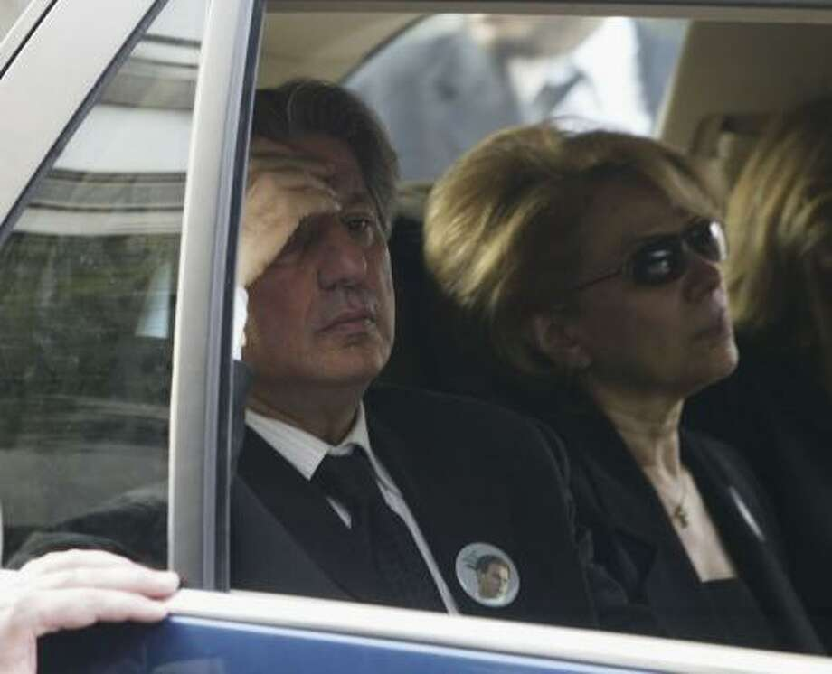 Former Lebanese President Amin Gemayel and his wife, Joyce, arrive at the funeral of their son, the assassinated Lebanese Industry Minister Pierre Gemayel in Beirut. Photo: Salah Malkawi, Getty Images