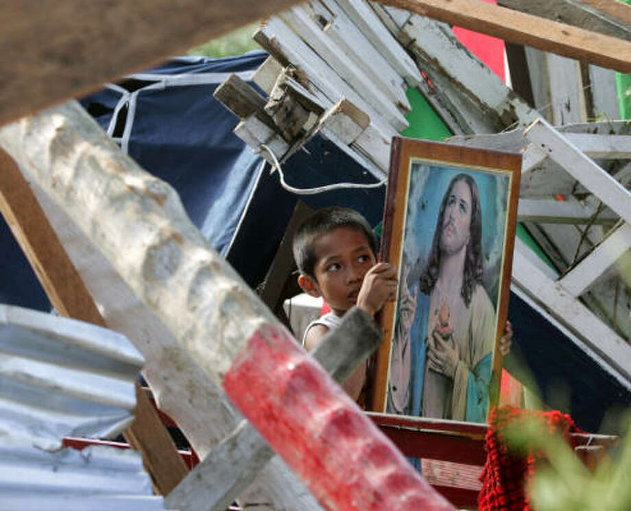 A picture of Jesus Christ is found among the ruins in Camarines Sur province Friday after Typhoon Durian hit the main island of Luzon. Photo: BULLIT MARQUEZ, AP
