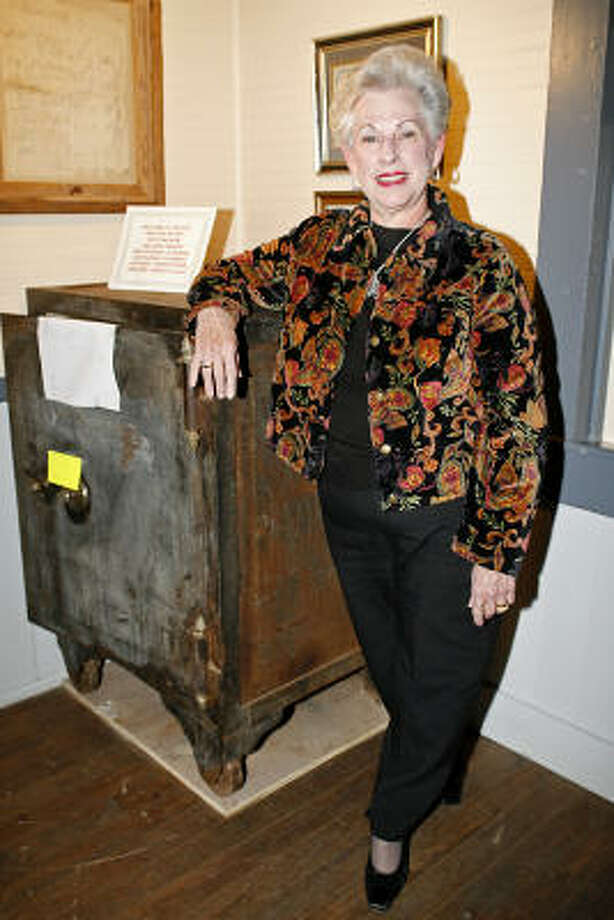 MKT Depot patron Jane Hurst donated an iron safe to the MKT Depot Museum. The safe had been in her father's store for more than 40 years before she inherited it. Photo: Diana L. Porter, For The Chronicle