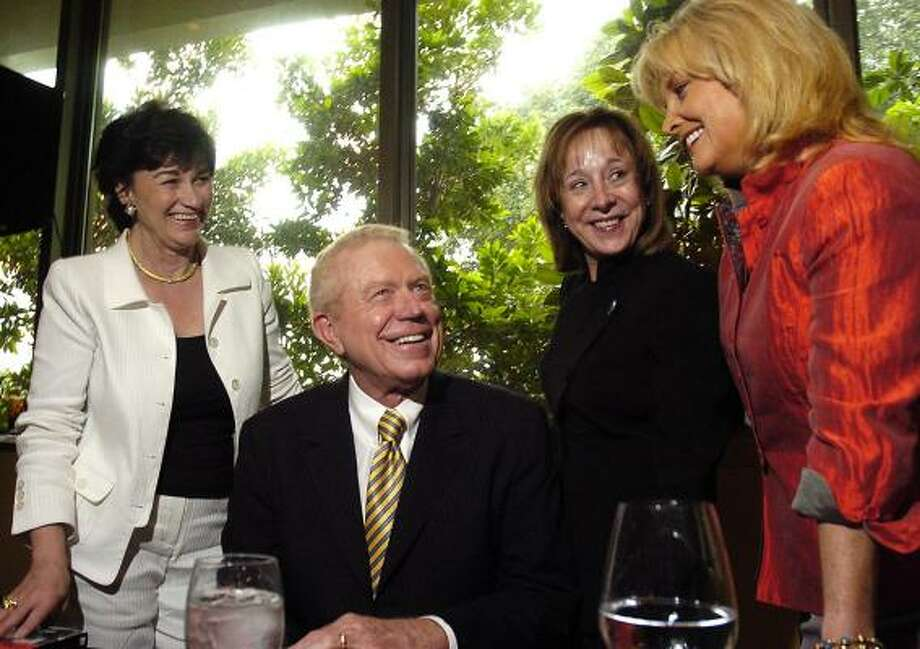 Ben Barnes grabs the admiration of book-signing party hostesses, from left, Linda Gale White, Nene Foxhall and Shara Fryer at Tony's. Photo: Dave Rossman, For The Chronicle