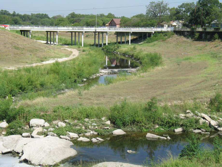 For decades, the San Antonio River south of downtown was engineered to emphasize flood control. Now the U.S. Army Corps of Engineers plans to restore it to a more natural state. Photo: John Gonzalez, Chronicle