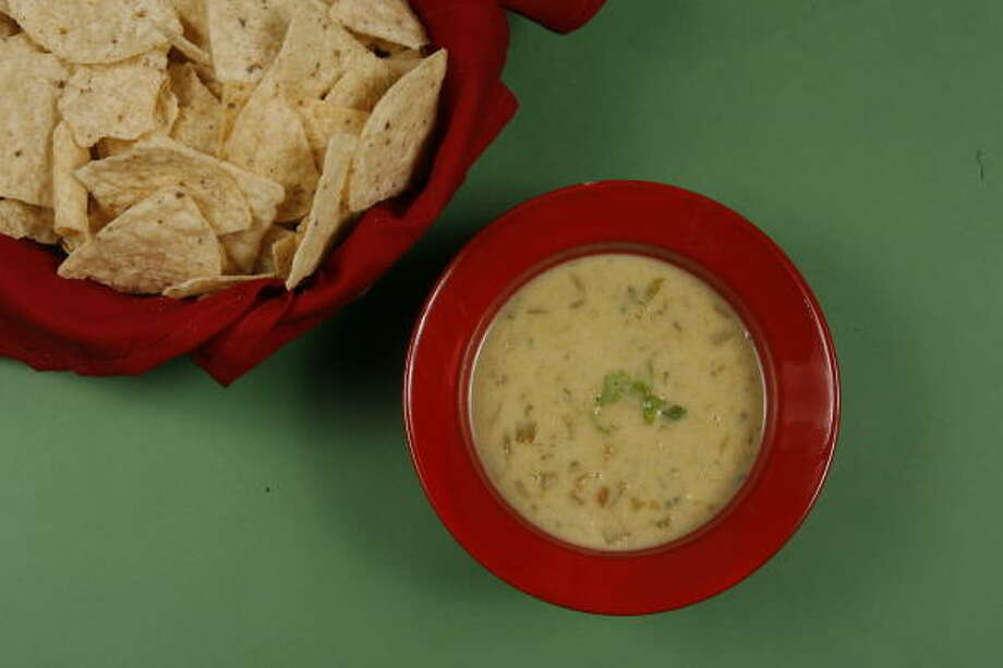 Tortilla chips can't wait to take a dip in Queso Blanco. Photo: Steve Campbell, Chronicle