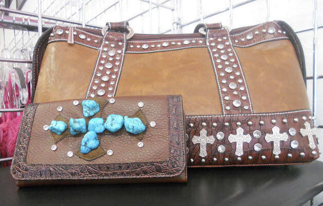 Turquoise-cross brown zebra wallet, $25, and cross-rhinestone purse, $49, can be found at Hip Dingo. JENNIFER RODRIGUEZ / SPECIAL TO THE EXPRESS-NEWS