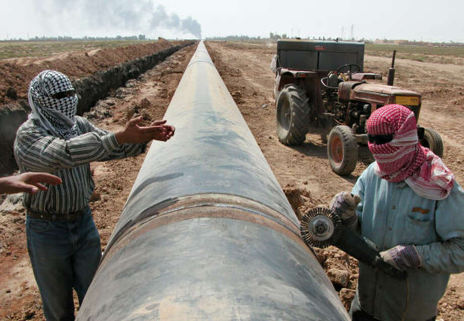As funding for new construction in Iraq dries up, U.S. officials cite the increase in oil production to near-prewar levels as one of their successes. Photo: YAHYA AHMED, AP File