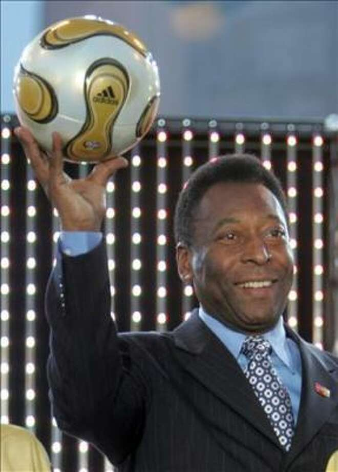 "Brazilian football legend Pele holds the ball that will be used in the final during the ""Fan Party"" in front of Berlin's Brandenburger Gate 07 June 2006, which will usher in the 2006 FIFA Football World Cup which takes place in Germany from 09 June to 09 July. AFP PHOTO JOHN MACDOUGALL Photo: JOHN MACDOUGALL, AFP"