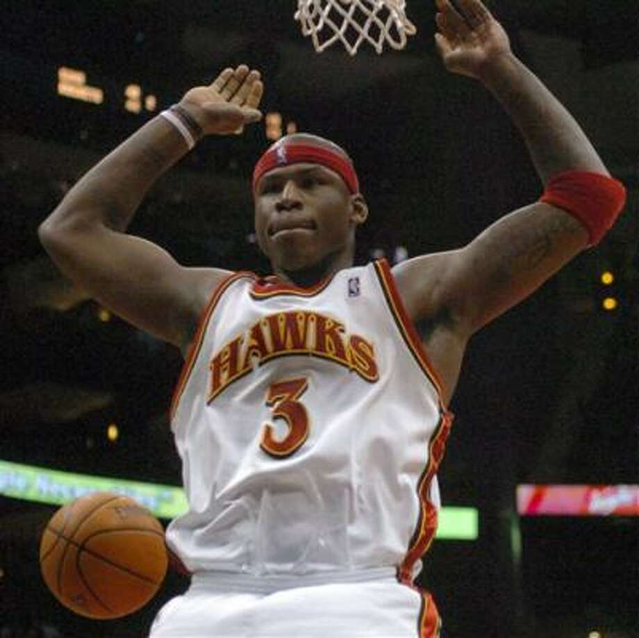 Al Harrington will be doing his dunking in Indiana from now on. Photo: GREGORY SMITH, AP