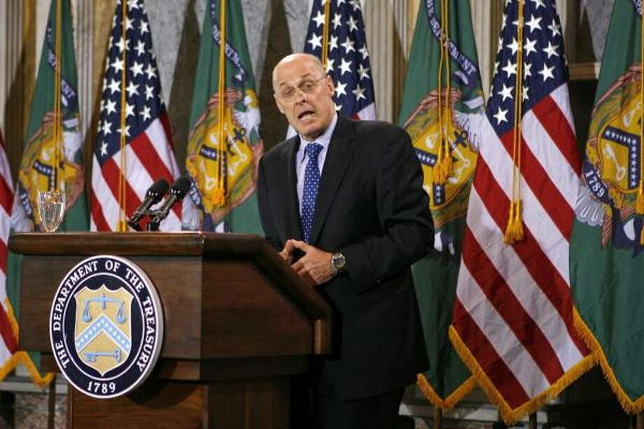 "Treasury Secretary Henry Paulson speaks about the international economy in Washington on Wednesday. Paulson said the administration ""will not heed the siren songs of protectionism."" Photo: KEVIN LAMARQUE, REUTERS"