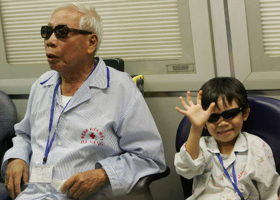"""Seven-year-old Lam Vu Nhat Ni, after her eye operation, said, """"Before I only saw planes in the sky, but now that I'm on board a plane I'm really happy. I don't feel like I'm in a hospital."""" Photo: AARON FAVILA, AP"""