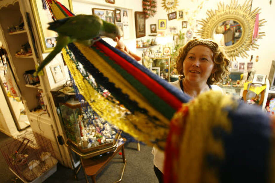 """Ercilia Sandoval plays with one of her daughters' parrots. For months, she's been on a public crusade against Houston janitorial companies who she says treat their workers like """"toilet paper."""" Photo: Nick De La Torre, CHRONICLE"""