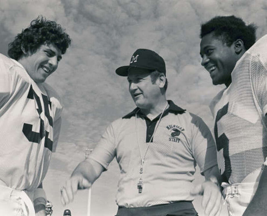 Bo Schembechler (shown with players in 1975 before the Orange Bowl) was feared and respected by Michigan athletes. Photo: BILL HUDSON, AP