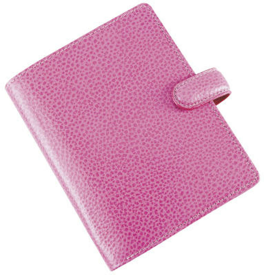 Get organized with a pink Filofax. ($50 at the Container Store; $5 goes to the Avon Foundation's Breast Cancer Crusade) Photo: The Container Store