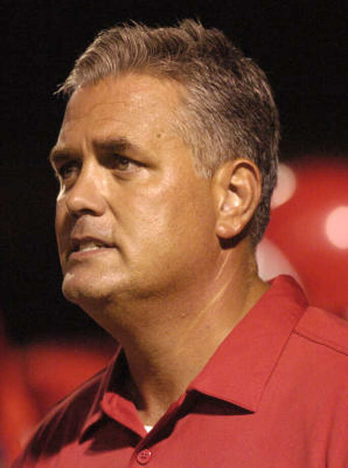 ``We're going to run the ball and mix in some short passing,'' said Kurt Page, the former Vanderbilt quarterback and successful high school coach in Tennessee and Alabama. ``We're going to run Miami's 4-3 defense. We aren't doing anything too fancy.'' Photo: Dave Rossman, For The Chronicle
