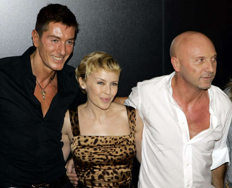 Australian pop star Kylie Minogue poses with fashion designers Stefano Gabbana, left, and Domenico Dolce backstage at Dolce & Gabbana's Spring/Summer 2007 fashion show on Thursday. Photo: ANTONIO CALANNI, AP