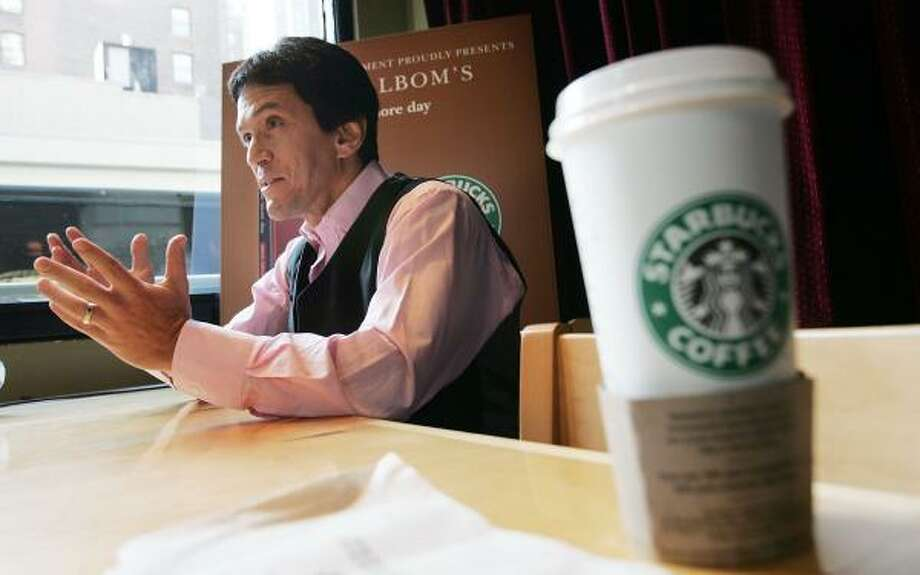 Mitch Albom discusses his new book, For One More Day, during a stop at a Starbucks in New York City. Photo: Mario Tama, Getty Images