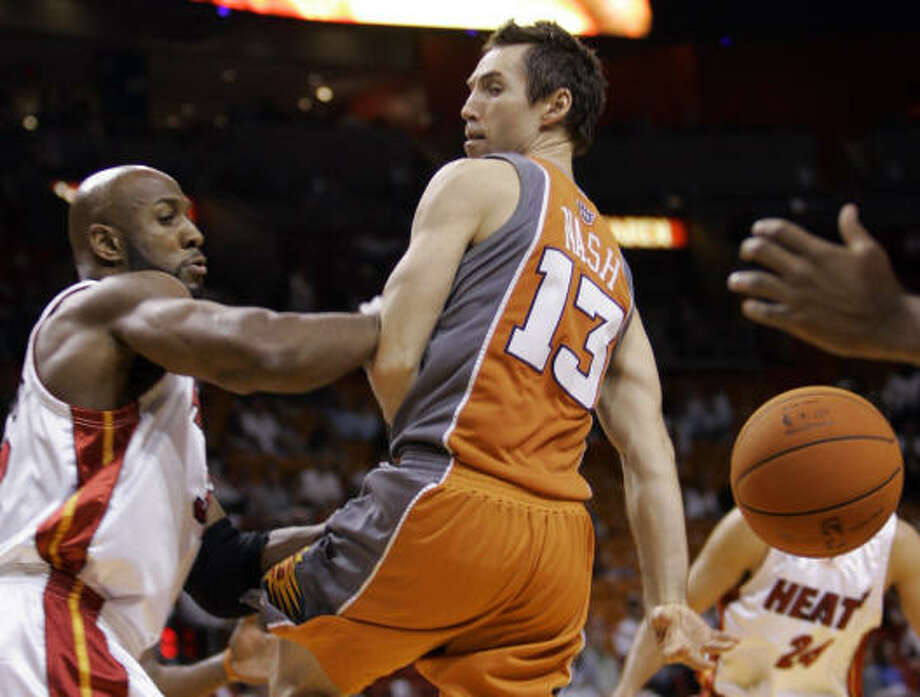 When he wasn't hitting a crucial 3-pointer down the stretch, Phoenix's Steve Nash (13) was going behind his back with a pass for one of his 11 assists in Wednesday's 99-89 victory at Miami -- the Suns' 12th consecutive win Photo: Alan Diaz, AP